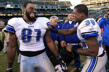 Calvin Johnson celebrating after a road win over Oakland